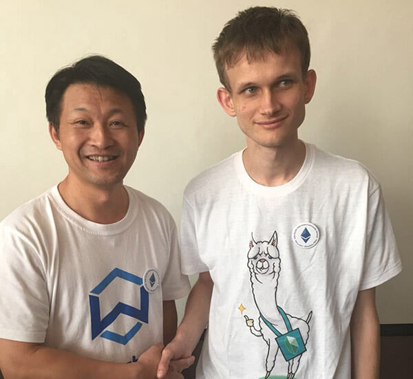 Jack Lu pictured with Vitalik Buterin