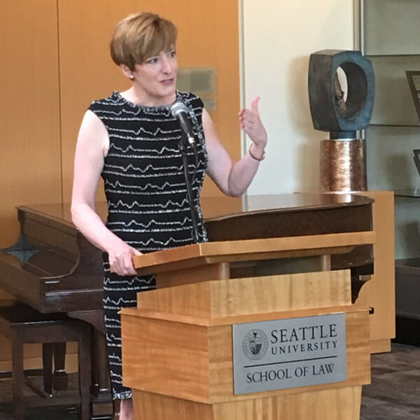 Caitlin Long speaking at Seattle University