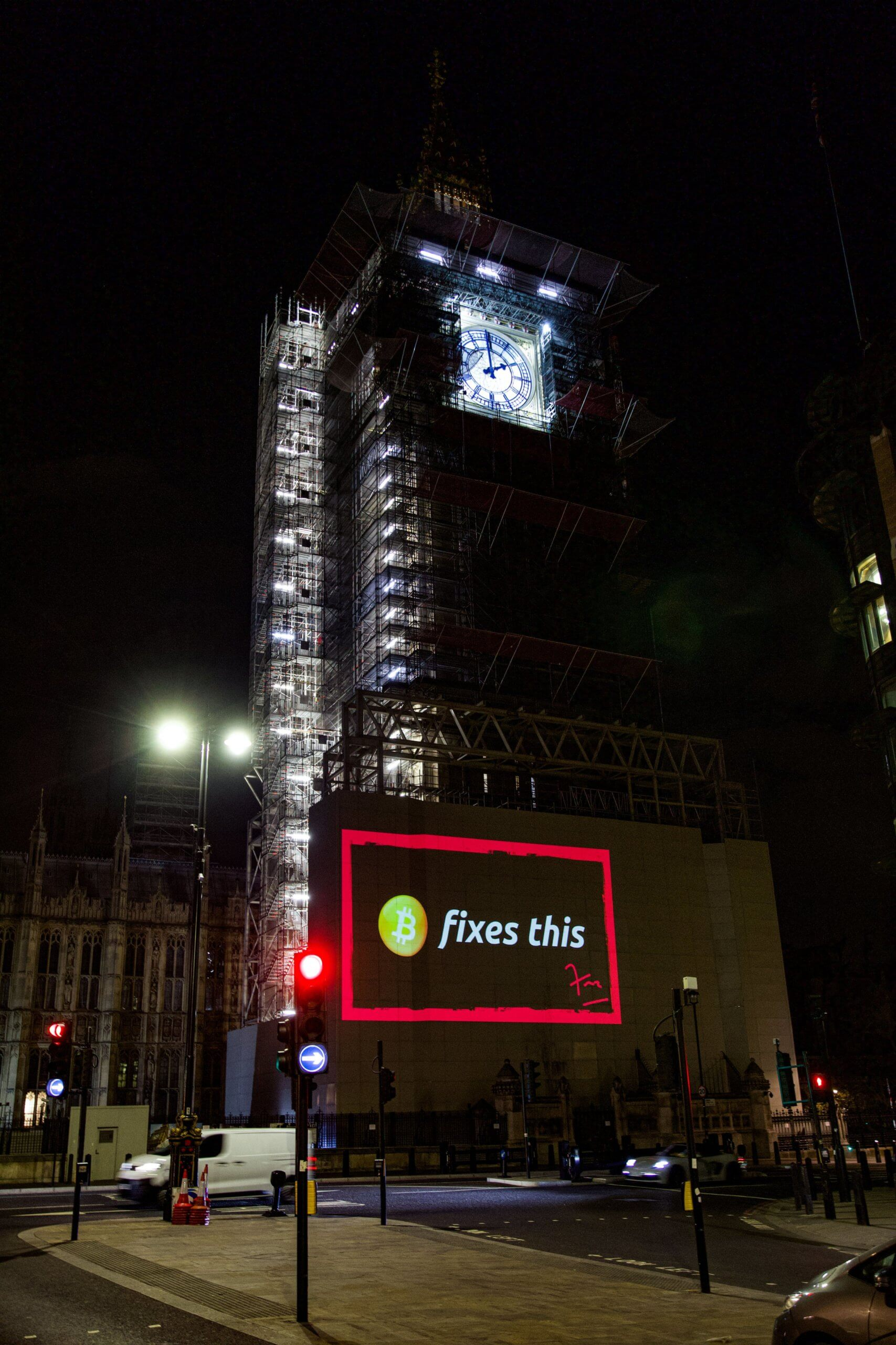 """Bitcoin fixes this"" projected on the Parliament building in London"